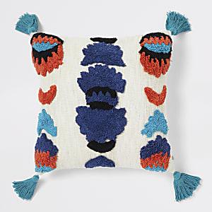 Crème kussens met blauw patroon en kwastjes