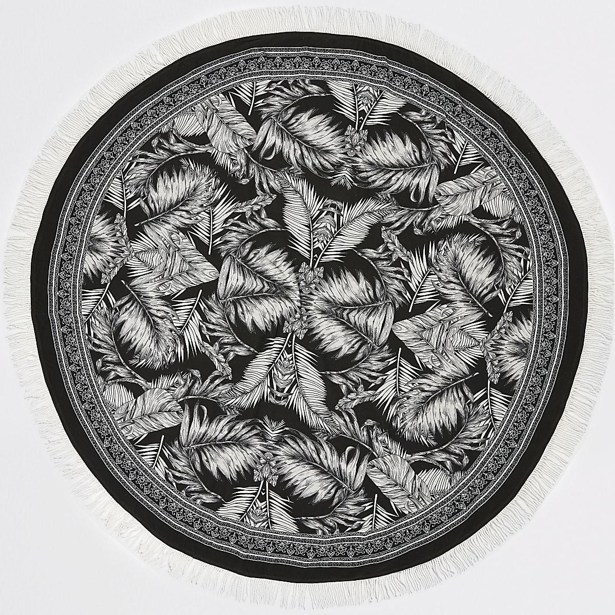 Serviette ronde à imprimé feuilles monochrome légère