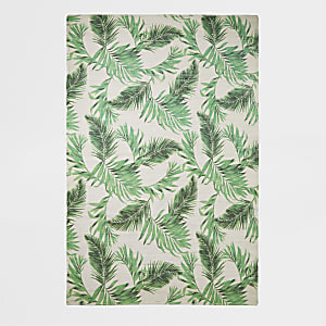 Handwoven recycled large green leaf print rug