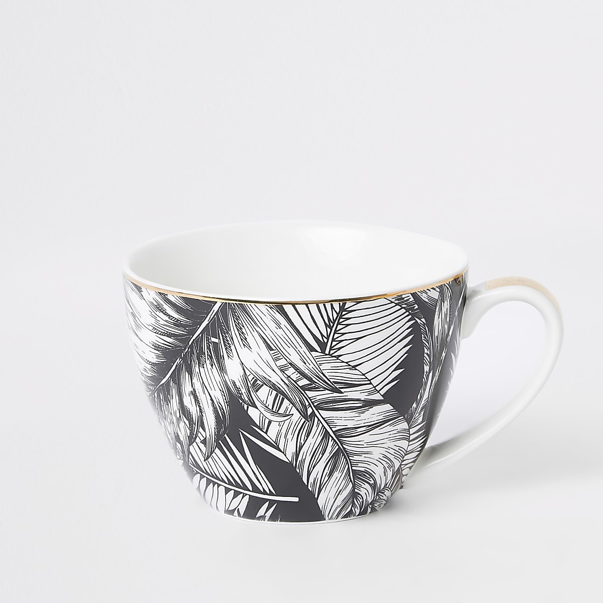 Zwart-witte mok met bladprint