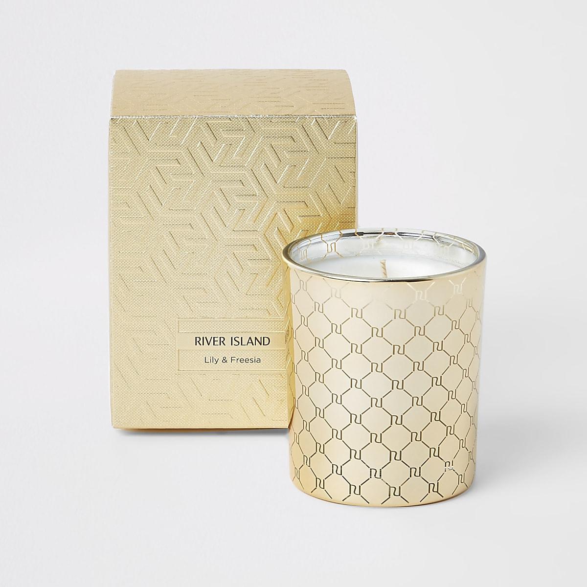 Bougie dorée parfum lys et freesia