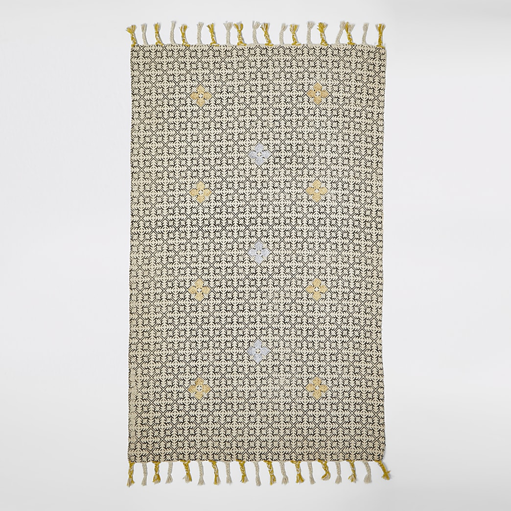 Small black and cream geo print rug