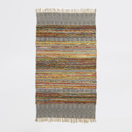 Small multicolored woven geo print rug