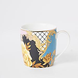 Blaue, geblümte Tasse mit RI-Logo