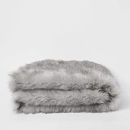 Grey faux fur throw with panther face reverse