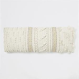 Oversize-Kissen aus Strick mit Bommeln in Creme