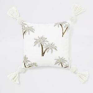 Klein beige kussen met geborduurde palmboom