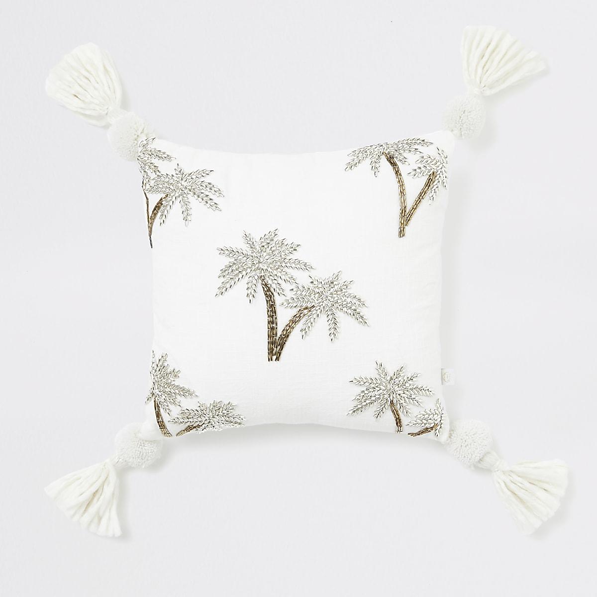 Petit coussin beige à broderie palmier