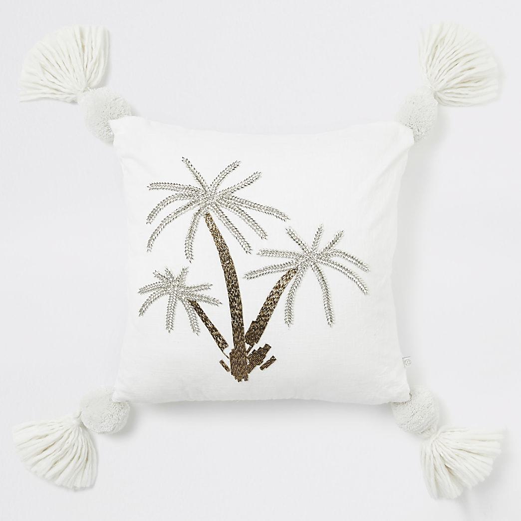 Groot beige kussen met geborduurde palmboom