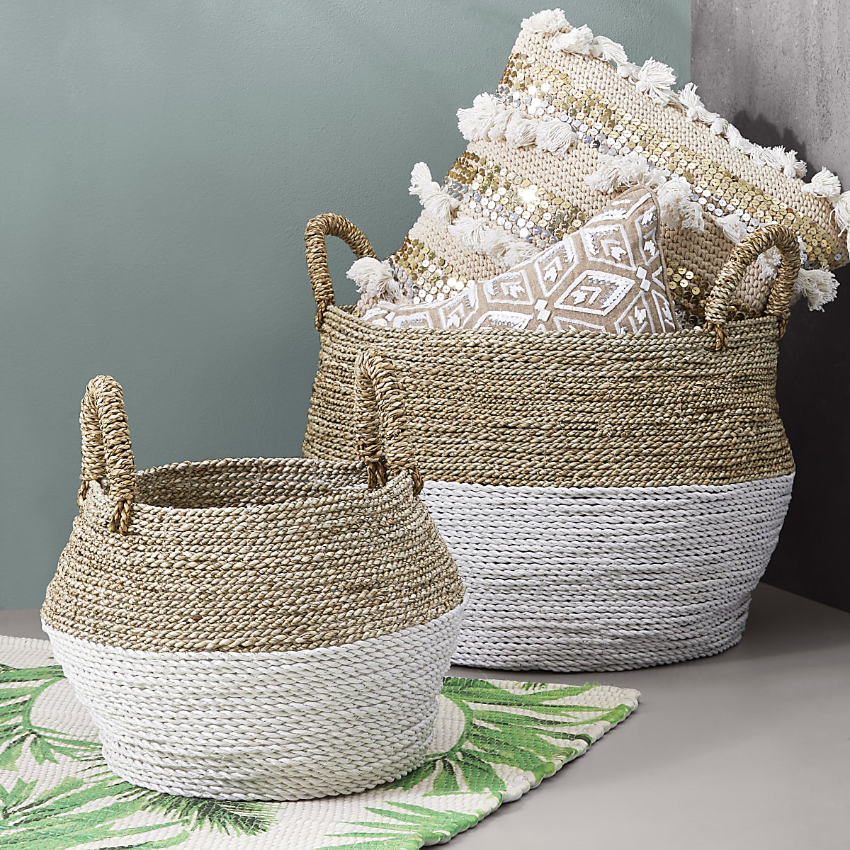 Beige set of two handwoven storage baskets