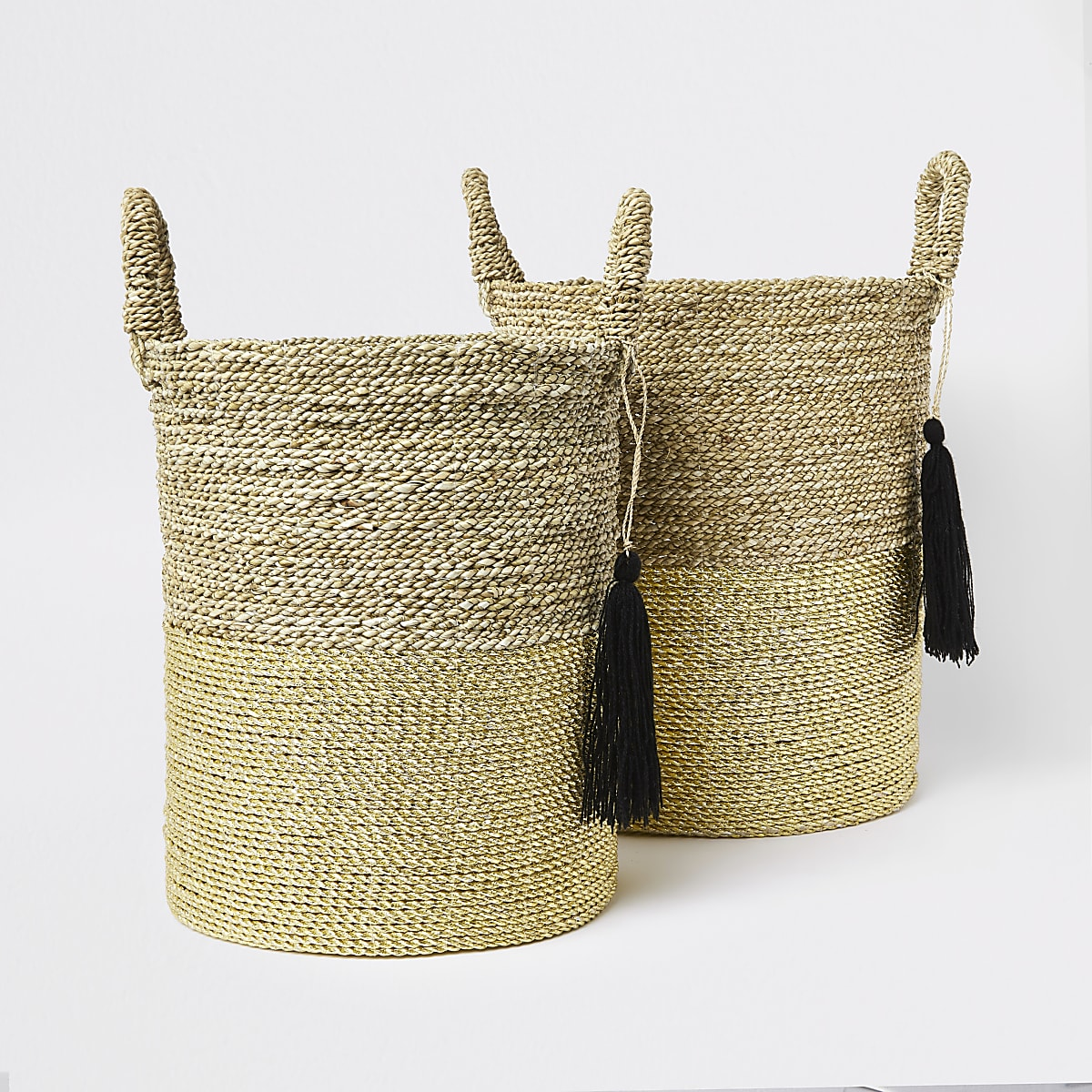 Gold set of two handwoven storage baskets