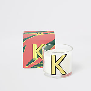 Red printed 'K' black cashmere candle