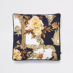 Blauwe kussenhoes met gebloemde, barokke print