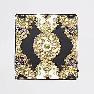 Housse de coussin noire avec médaillon animal