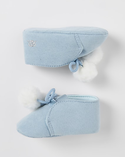 Baby blue pom pom booties