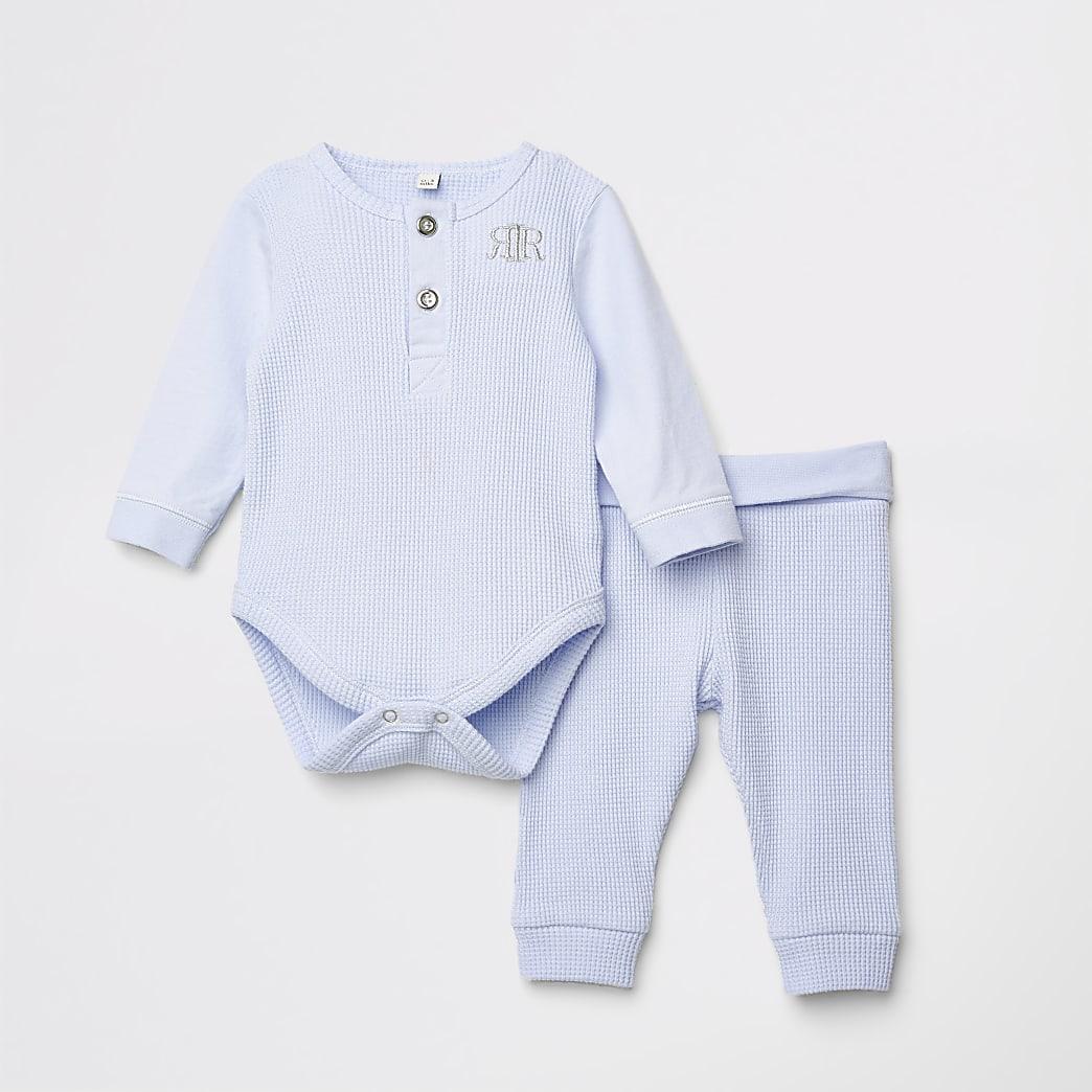 RI - Outfit met blauwe babygrow en legging voor baby's
