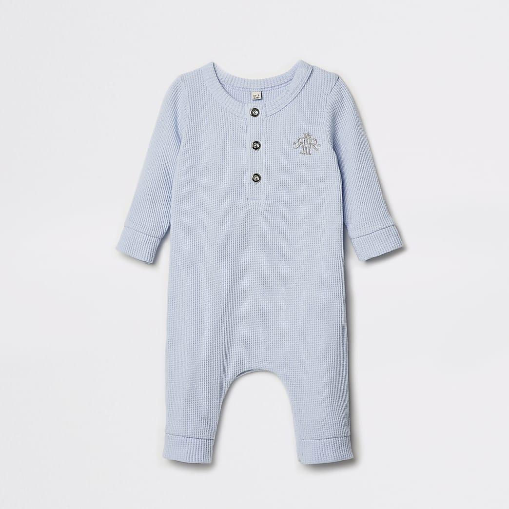 Blauw baby-growrompertjemet wafeldessin en kroon-print voor baby's