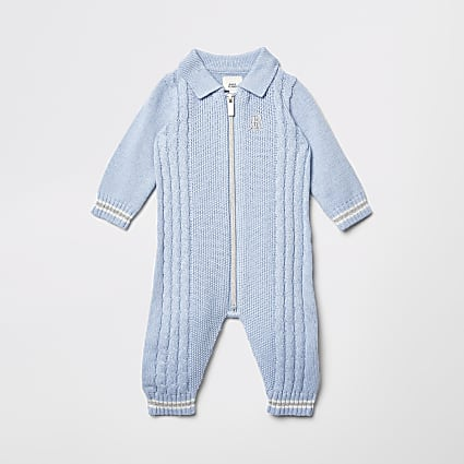 Baby blue zip front cable knit baby grow