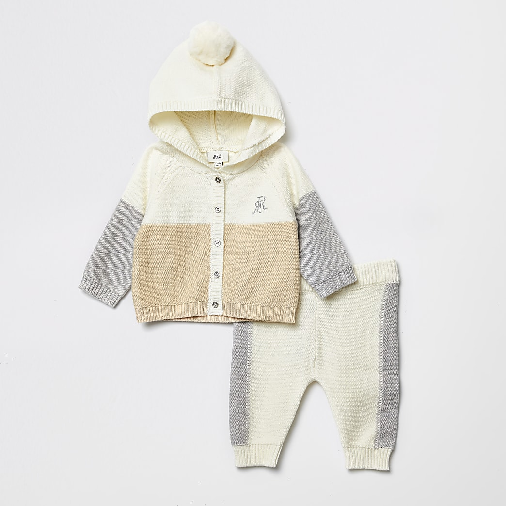 Baby cream blocked knitted cardigan outfit