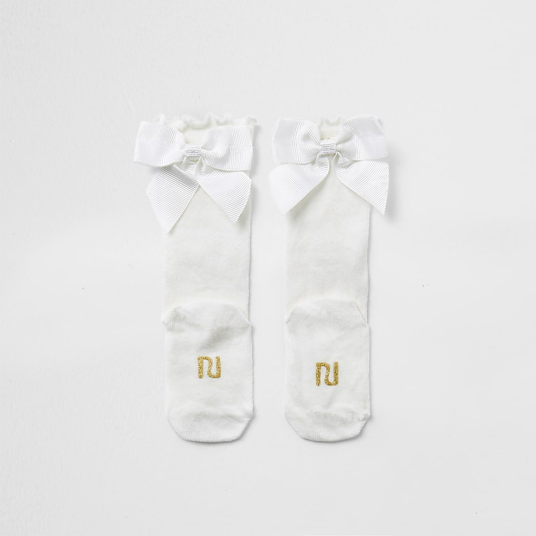 Baby cream knee high bow socks
