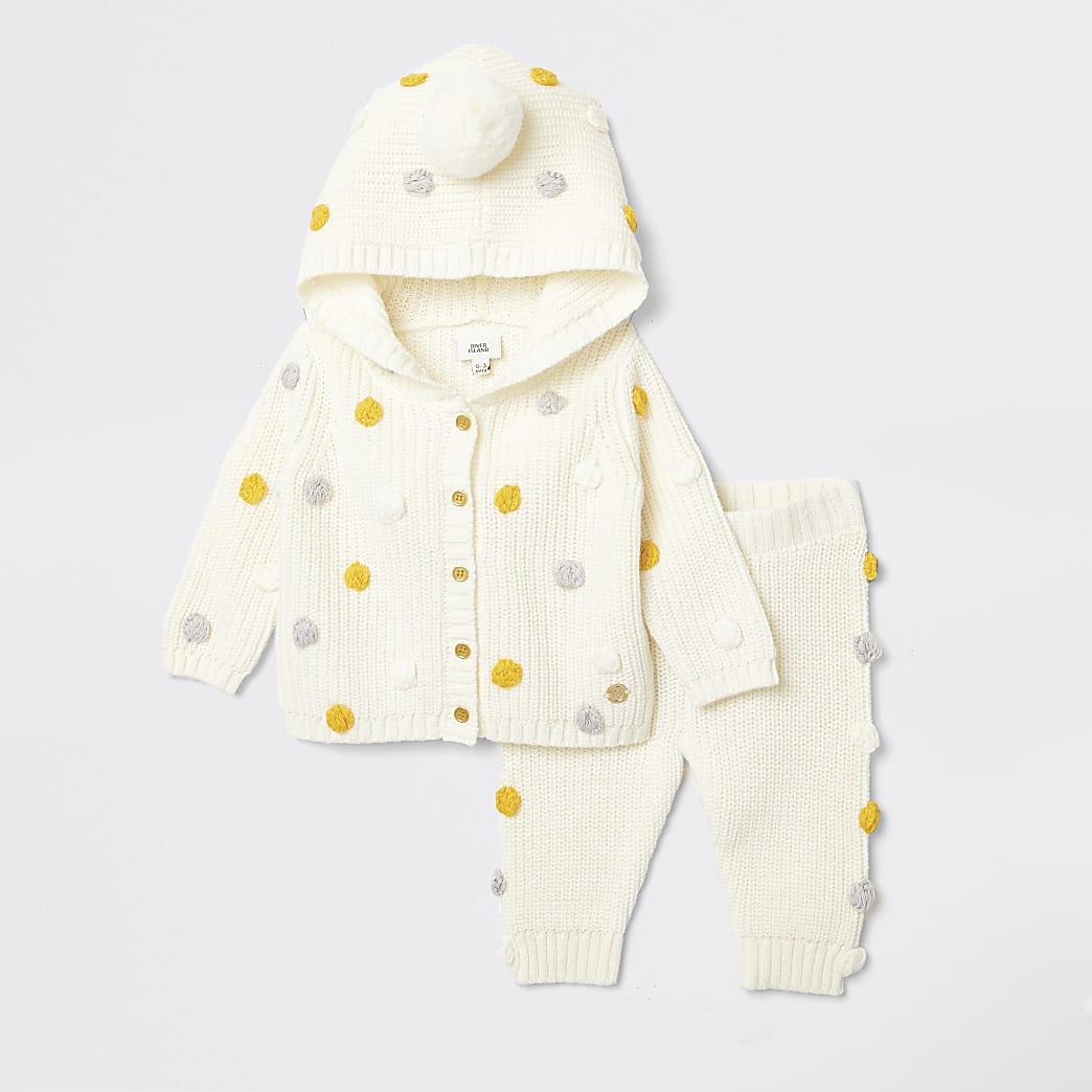 Outfit met crèmekleurig gebreid vest met capuchon voor baby's