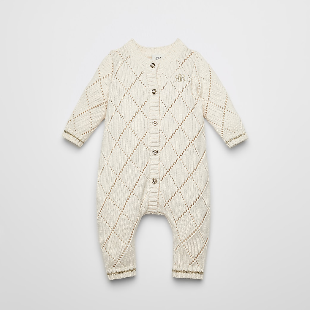 Crèmekleurigpointelle gebreid rompertje voor baby's