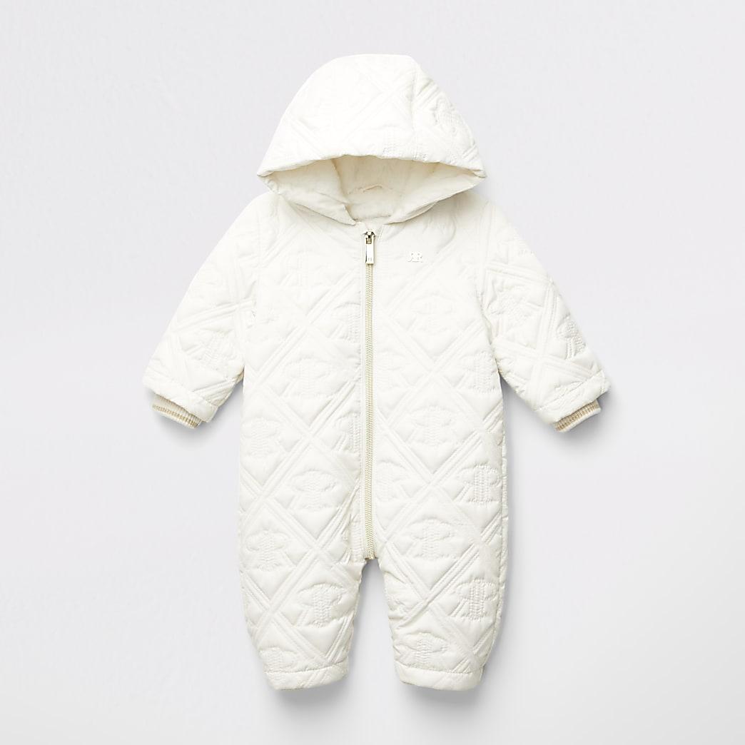 Crèmekleurig gevoerd sneeuwpak met RI-monogram in reliëf voor baby's