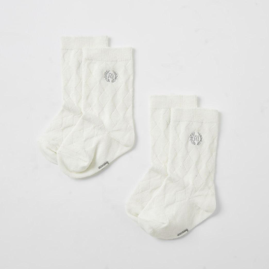 Crèmekleurige kniekousen met RI-print voor baby's