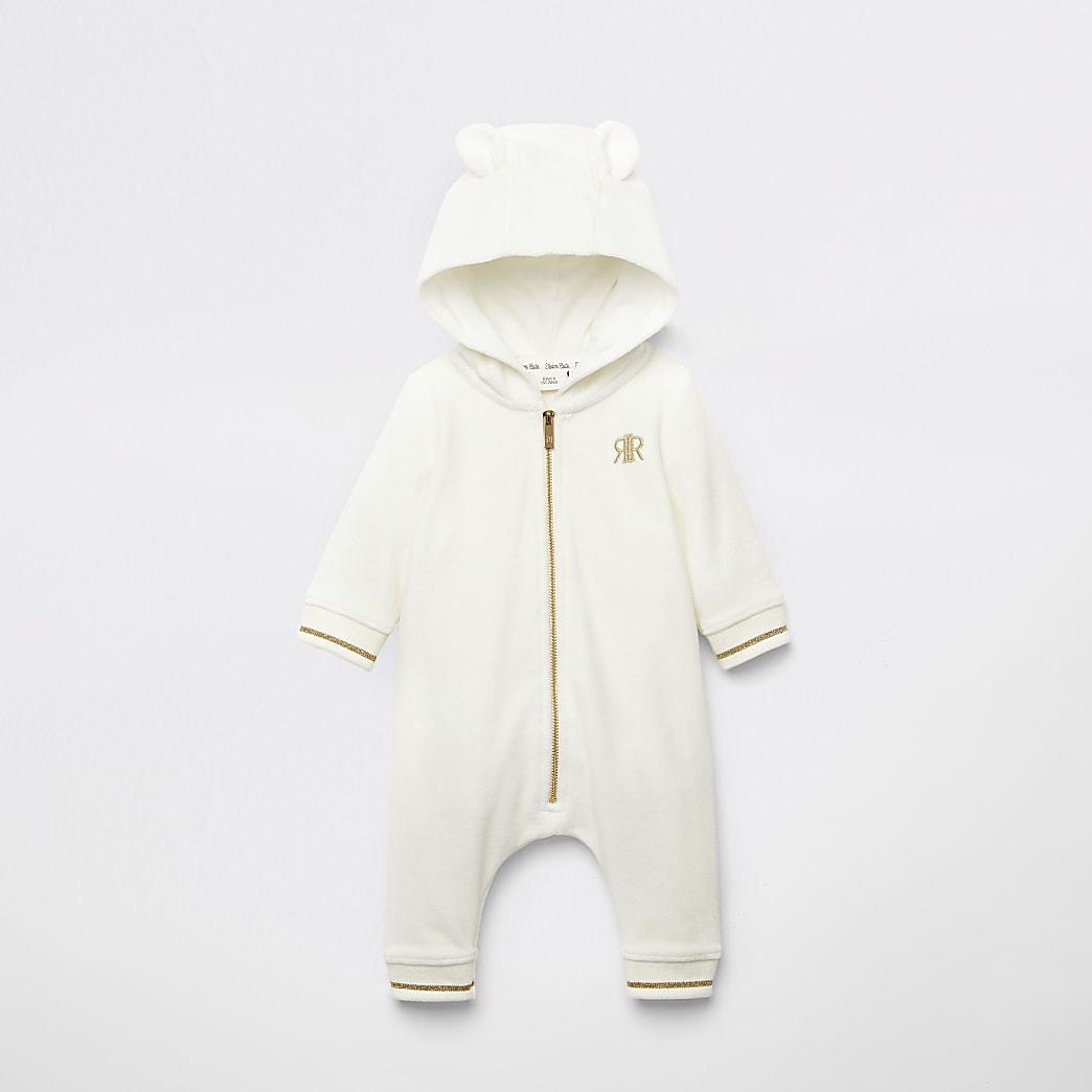 Crèmekleurige velours beer alles-in-een voor baby's