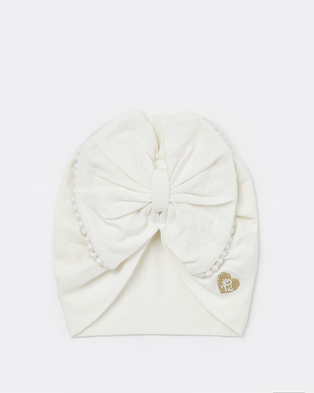 Baby girls cream bow trim turban