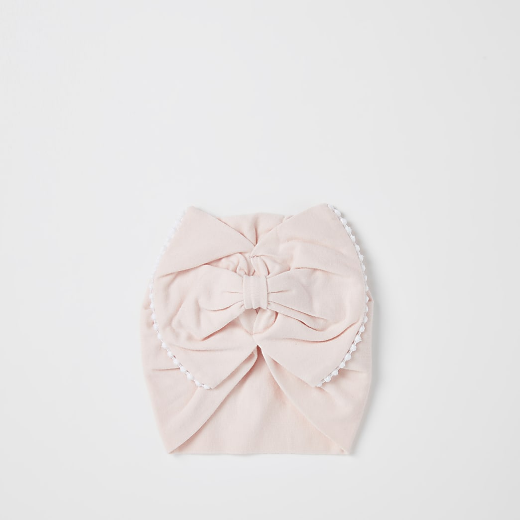 Baby girls pink trim bow turban