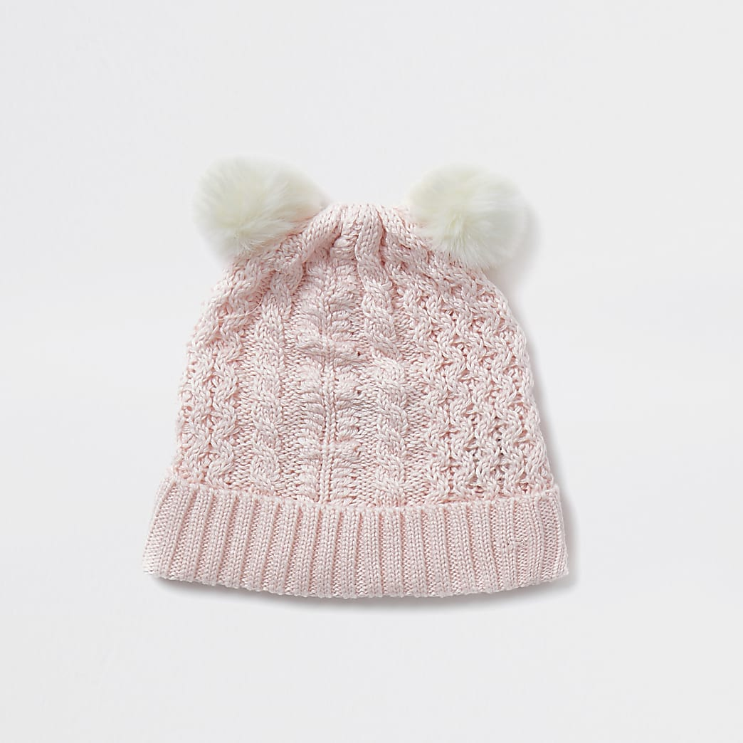 Baby pink cable knit pom pom beanie hat