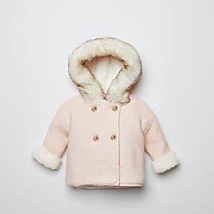 Pinke Strickjacke mit Kunstfellkapuze für Babys