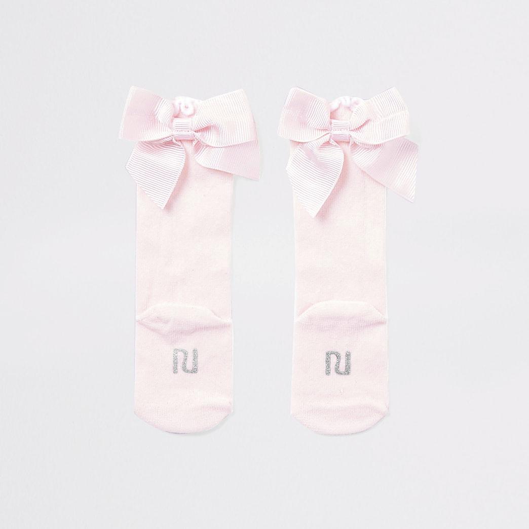 Roze kniekousen met strik voor baby's