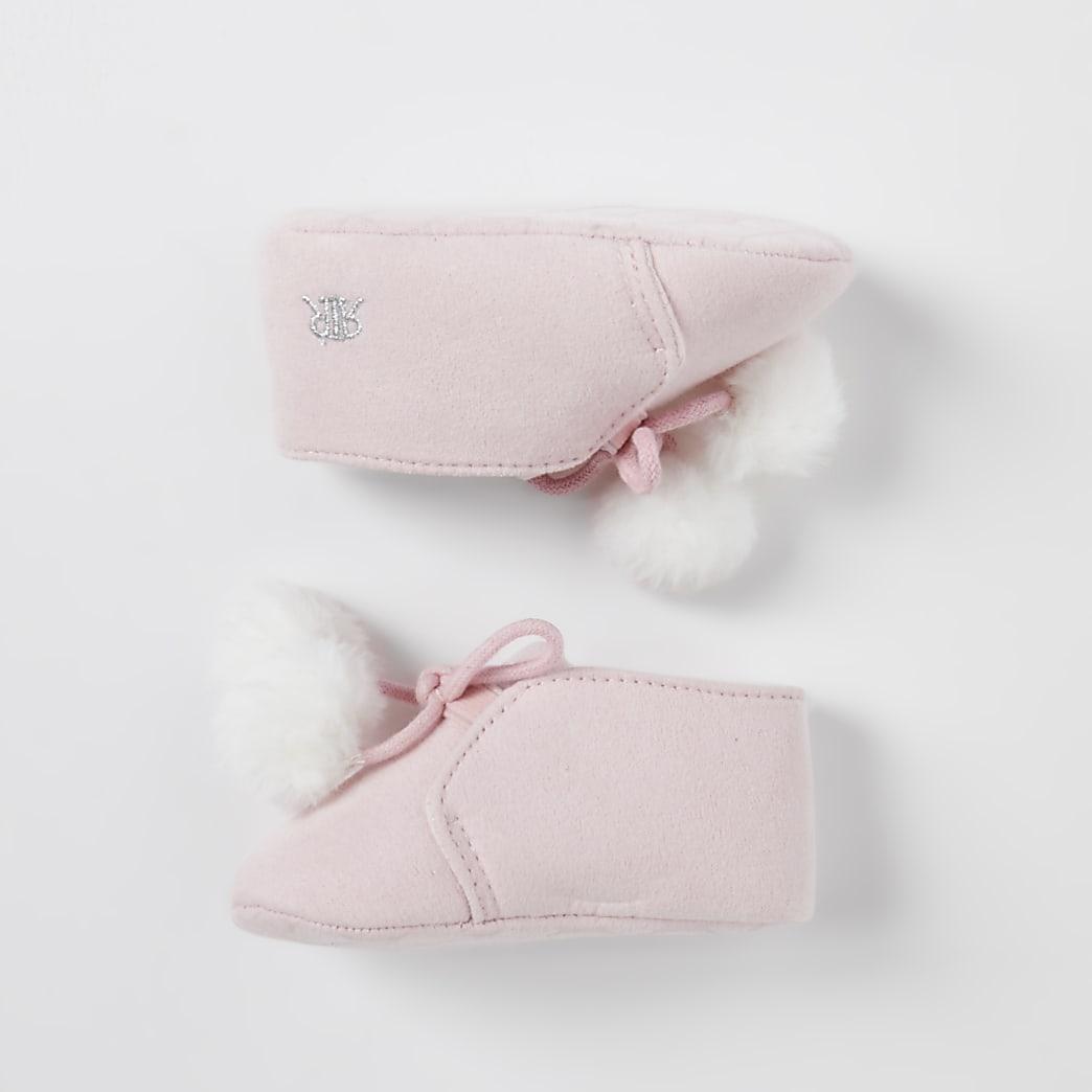 Baby pink pom pom booties