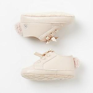 Roze sneakers met vetersluiting en pompons voor baby's