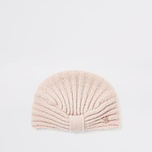 Pinkfarbene Mütze im Turbanstil und Rippenstrick für Babys
