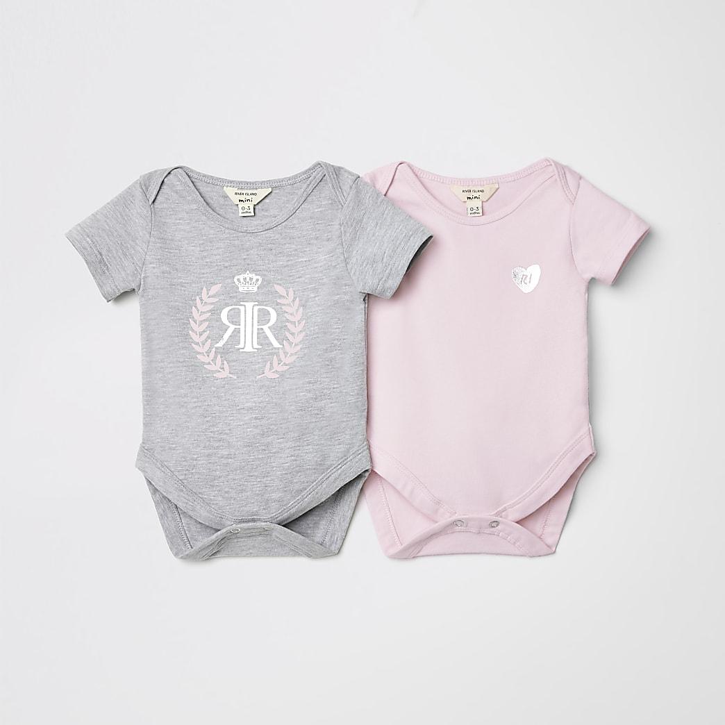 Set van twee babyroze rompertjes