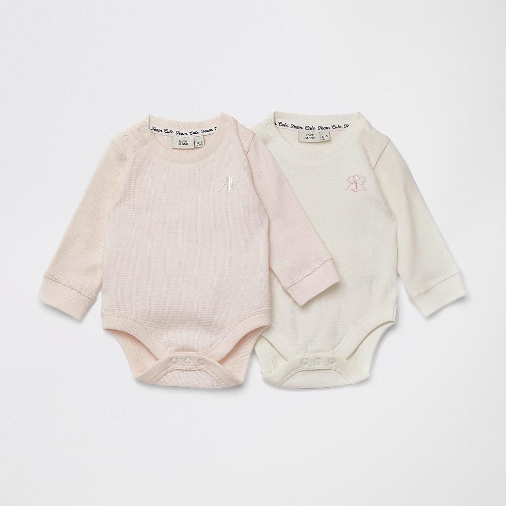 Set van 2 roze bodysuits met wafeldessin en RIR-print voor baby's