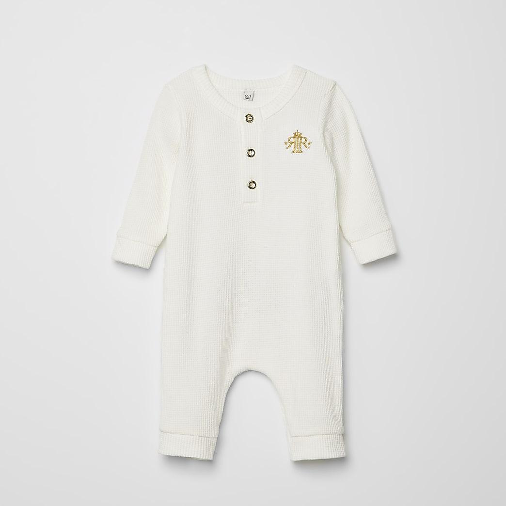 Wit rompertje met wafeldessin en kroonprint voor baby's