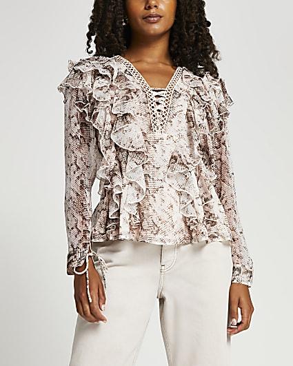 Beige animal print ruffled blouse