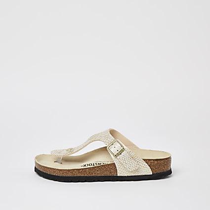 Beige Birkenstock snake print sandals