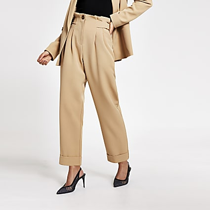Beige buckle side tapered peg trousers
