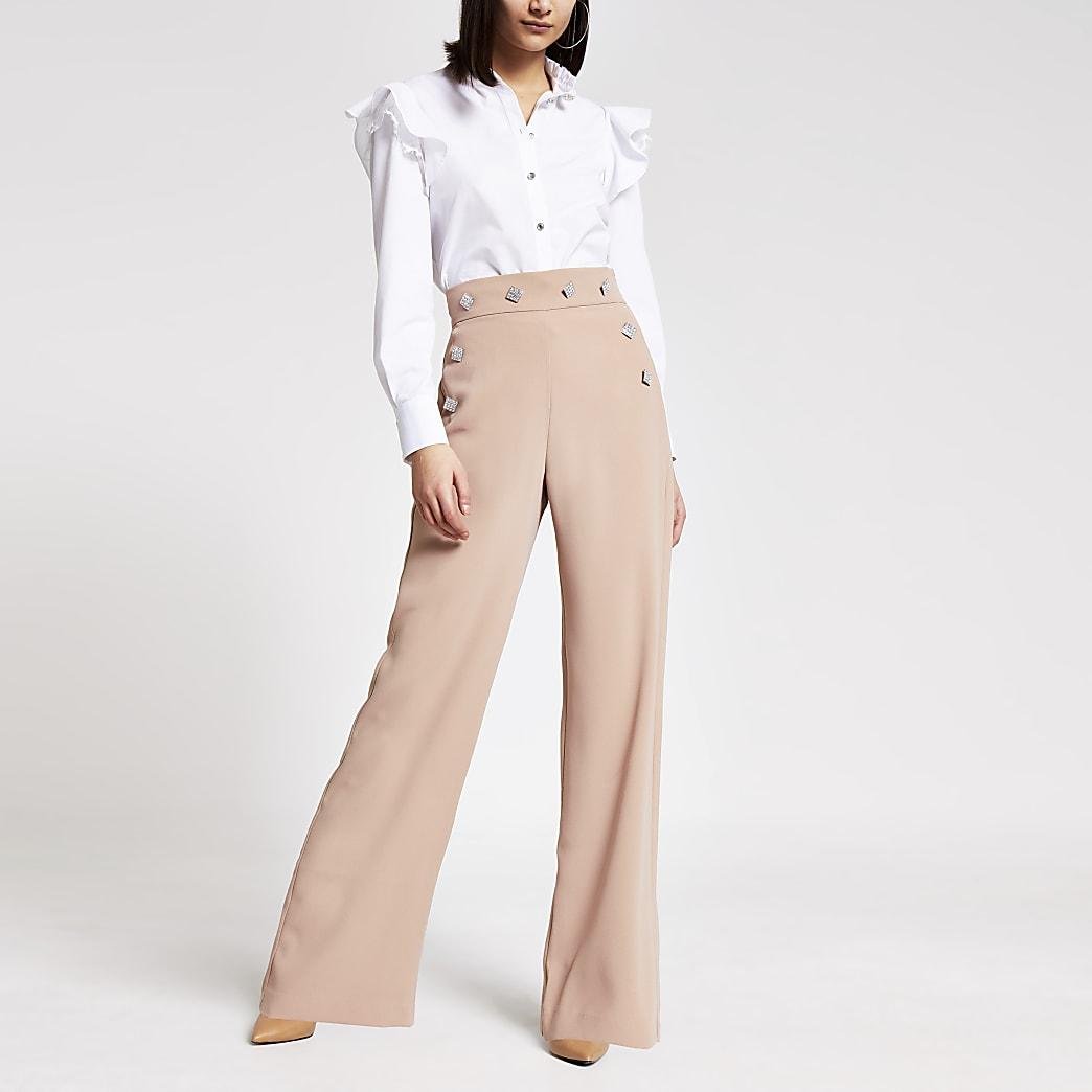 Pantalon jambes larges beige avec boutonà strass