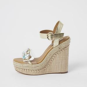 Beige Sandalen mit Keilabsatz und Verzierung