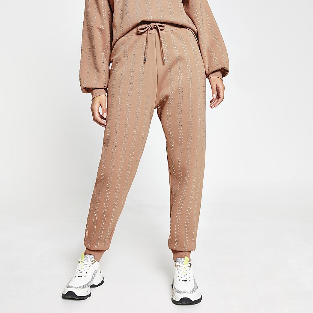Beige embellished strip cuffed joggers