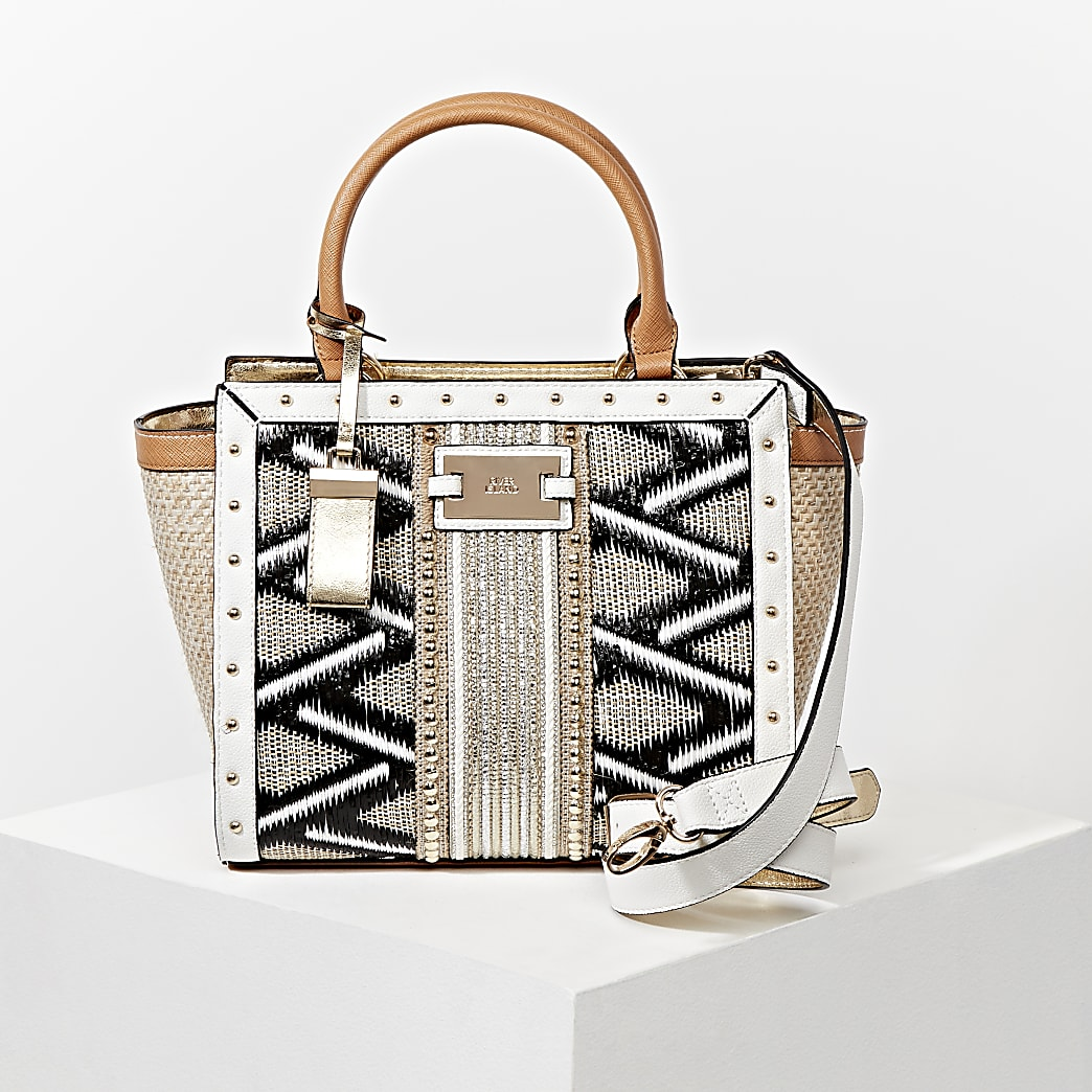 Beige embellished weave mix wing tote