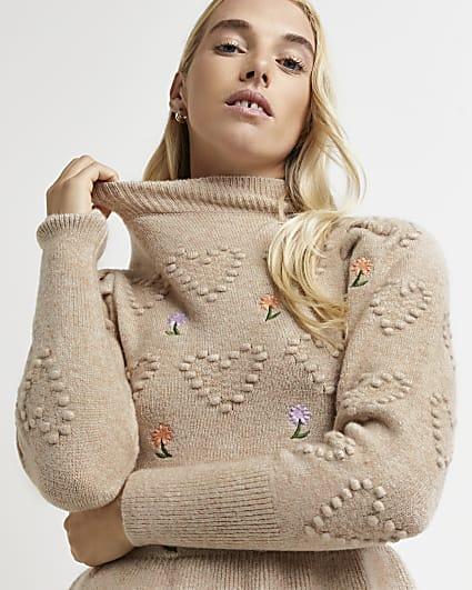 Beige embroidered peplum hem knitted jumper