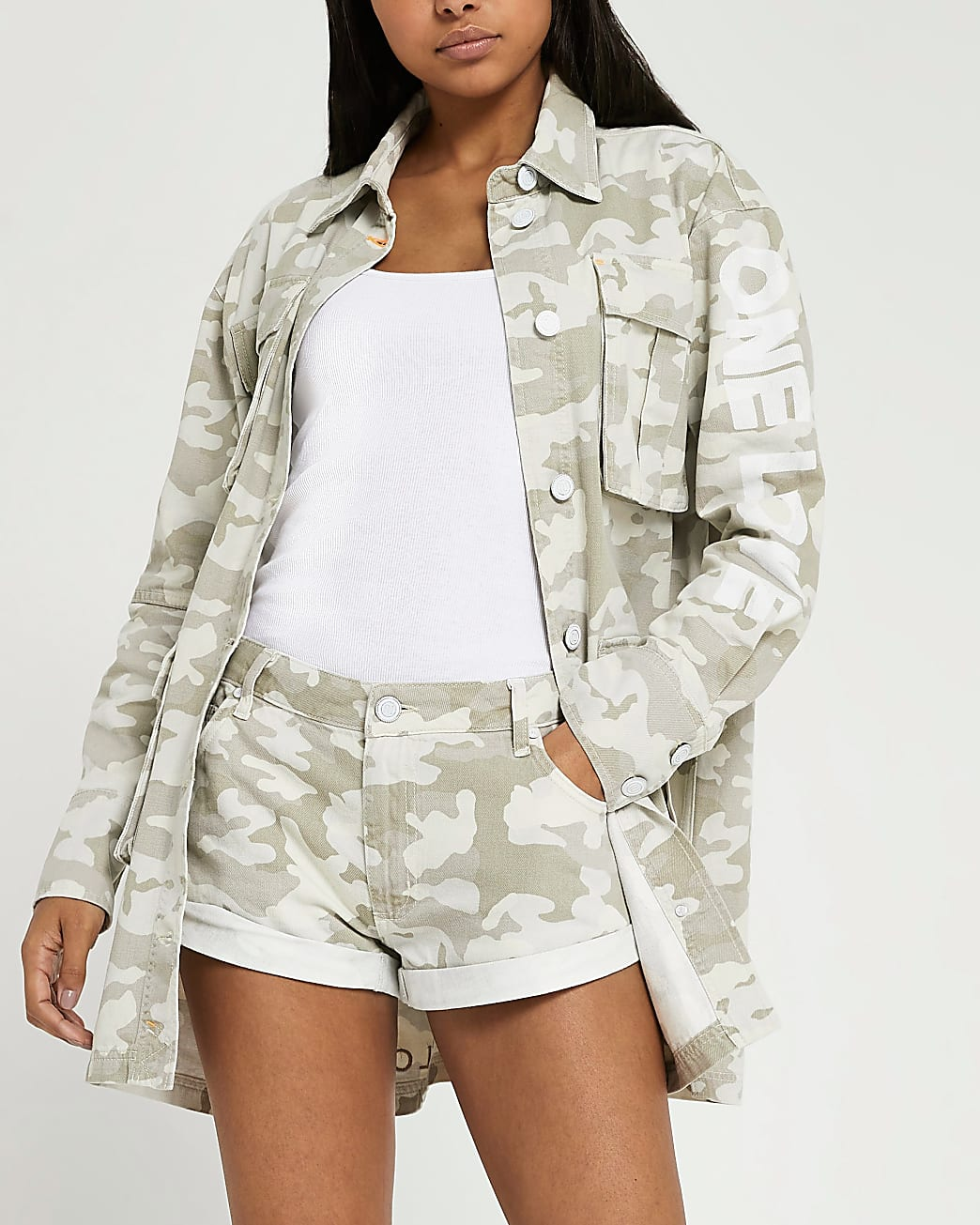 Beige embroidered turn up camo print shorts
