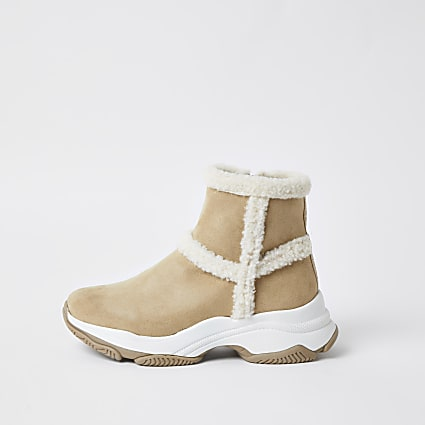 Beige faux fur exposed seam boots